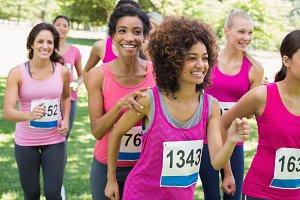 Participants of breast cancer marathon running