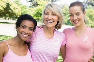 Multiethnic volunteers participating in breast cancer awareness