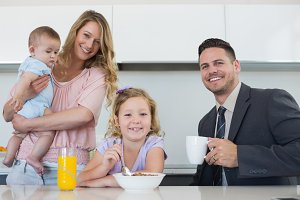 Happy family at table in house