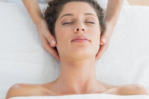 Woman receiving massage in health spa