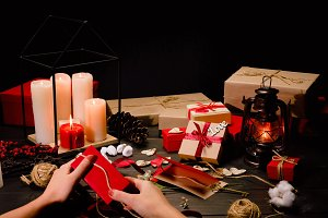 Female hands packing gift