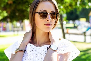 Summer, fashion and people concept - lifestyle portrait stylish pretty woman in sunglasses against colorful wall in city, street  among the trees, business brunette girl, looks into distance