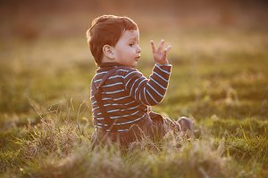 little beautiful boy on field