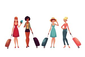 Young fashionable women, girls traveling with luggage, suitcases