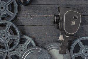 Old movie camera and film reel