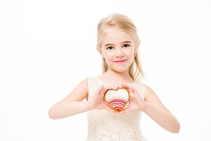 Girl holding heart shaped cookie