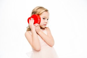 Girl holding heart shaped box