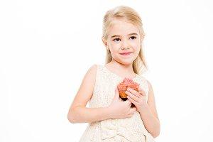 Girl holding festive cupcake