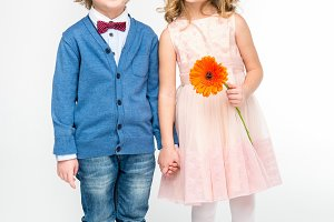 Kids with flower holding hands