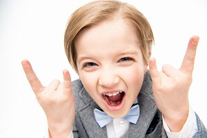 Excited boy showing rock sign