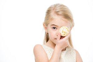 Little girl holding macaron