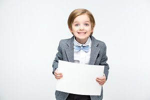 Excited boy with blank card