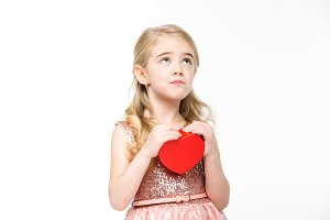 Little girl with red heart sign