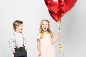 Kids with heart shaped balloons