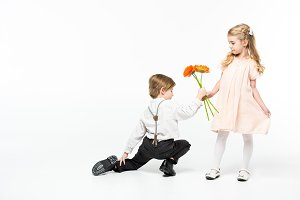 Boy giving flowers to cute girl