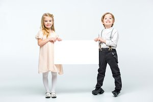 Little kids holding blank card