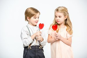 kids eating heart shaped lollipops