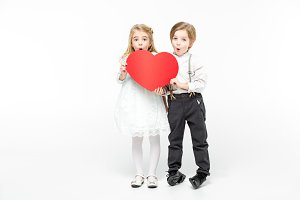 boy with girl holding paper heart