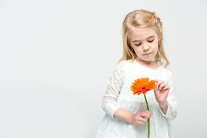 Little girl with gerbera flower
