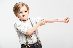 Boy with word love written on hand