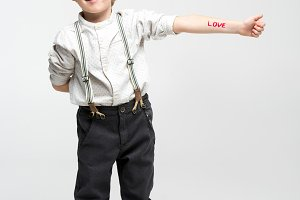 Boy with word love written on hand