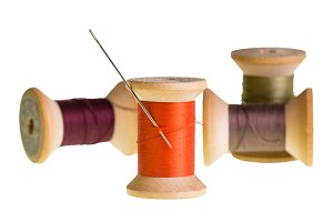 Spools of thread and needle