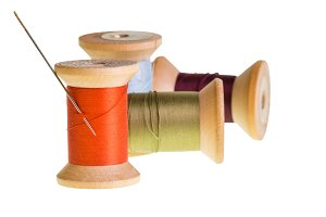Needle with spools od thread