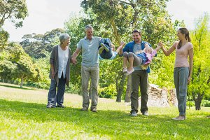 Happy extended family walking in park