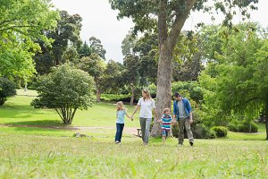 Parents and kids walking in park