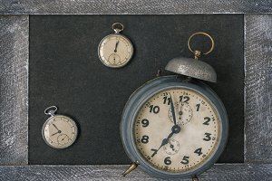 Old pocket watch and alarm clock