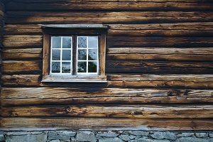 Dark timbered wooden wall with window