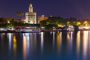 Torre del Oro at night in Seville, Spain