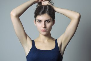 Young lady pulling her hair up