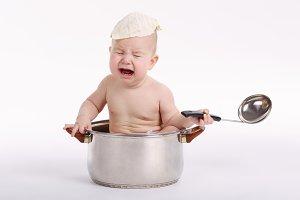 little funny boy sitting in pan