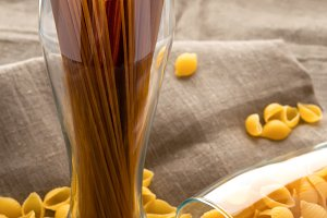Brown and yellow pasta in glass