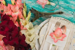 Tableware and silverware with and decorations gladiolus