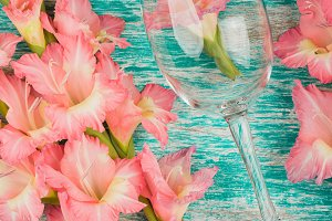 Wineglass with light pink gladiolus
