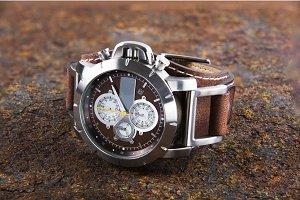 watch cronograph on rusty metal