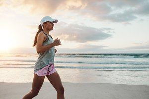Beautiful young woman jogging