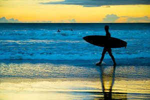 Surfer at the beach, Bali, Indonesia