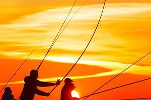 Fishers at beautiful sunset