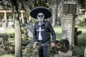Mexican costumes in a cemetery.