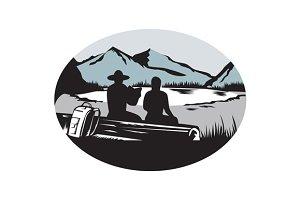 Two Trampers Sitting on Log Lake