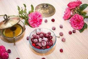 frozen cherry in a glass vase