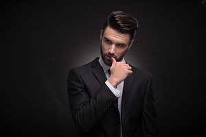 handsome man posing black suit shirt