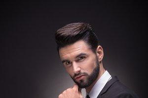 man posing hand profile sideway suit