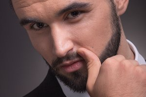 young man head face closeup beard