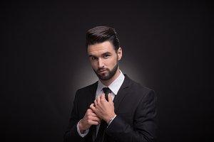 man suit tie necktie knot hands