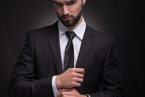 handsome man beard cuff links hands