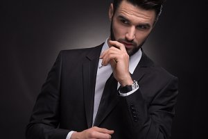 man elegant suit jacket posing black